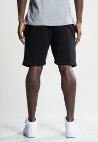 Ellesse - NOLI - Pantalones deportivos - anthracite - 2