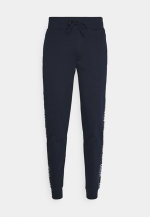 DASCHKENT - Tracksuit bottoms - dark blue