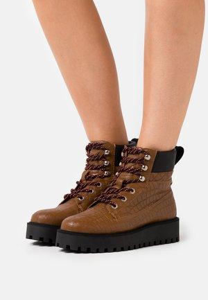 ALASKA - Winter boots - brown