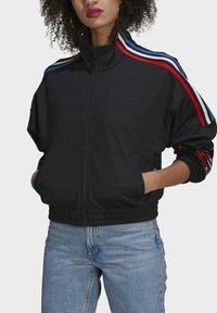 adidas Originals - ADICOLOR TRICOLOR TREFOIL PRIMEBLUE TRACK TOP - Training jacket - black - 3