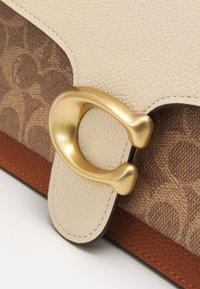 Coach - SIGNATURE TABBY SHOULDER BAG - Handbag - tan/ivory - 8