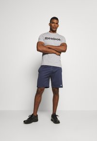 Reebok - SHORT - Pantalón corto de deporte - dark blue - 1