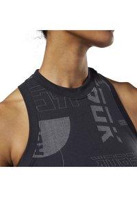 Reebok - MEET YOU THERE SEAMLESS CROPPED TANK TOP - Sports bra - black - 4