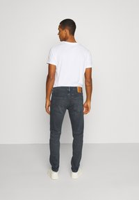 Levi's® - 512™ SLIM TAPER - Jeans slim fit - richmond blue black - 2