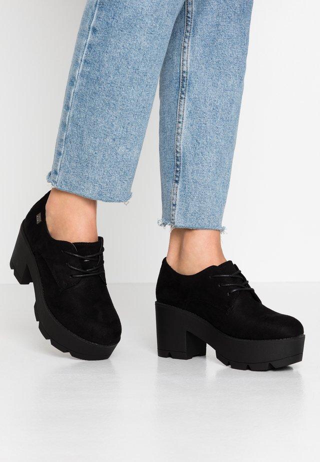 NANNY - Korte laarzen - black