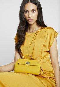 Gina Tricot - STINA MINI BAG - Bolso de mano - yellow - 1