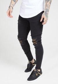 SIKSILK - BURST KNEE LOW RISE - Jeans Skinny Fit - washed black - 0