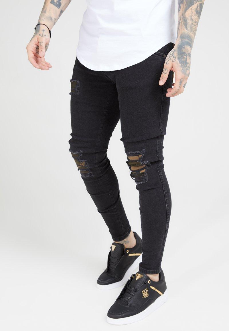 SIKSILK - BURST KNEE LOW RISE - Jeans Skinny Fit - washed black