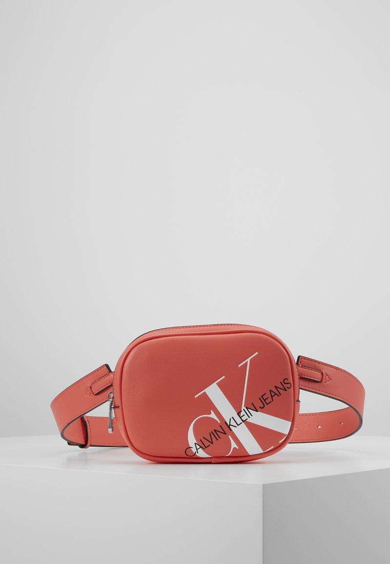 Calvin Klein Jeans - ROUNDED WAISTBAG - Bum bag - orange