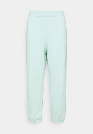 PANT TREND PLUS - Tracksuit bottoms - barely green/white