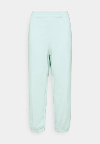 PANT TREND PLUS - Pantalon de survêtement - barely green/white