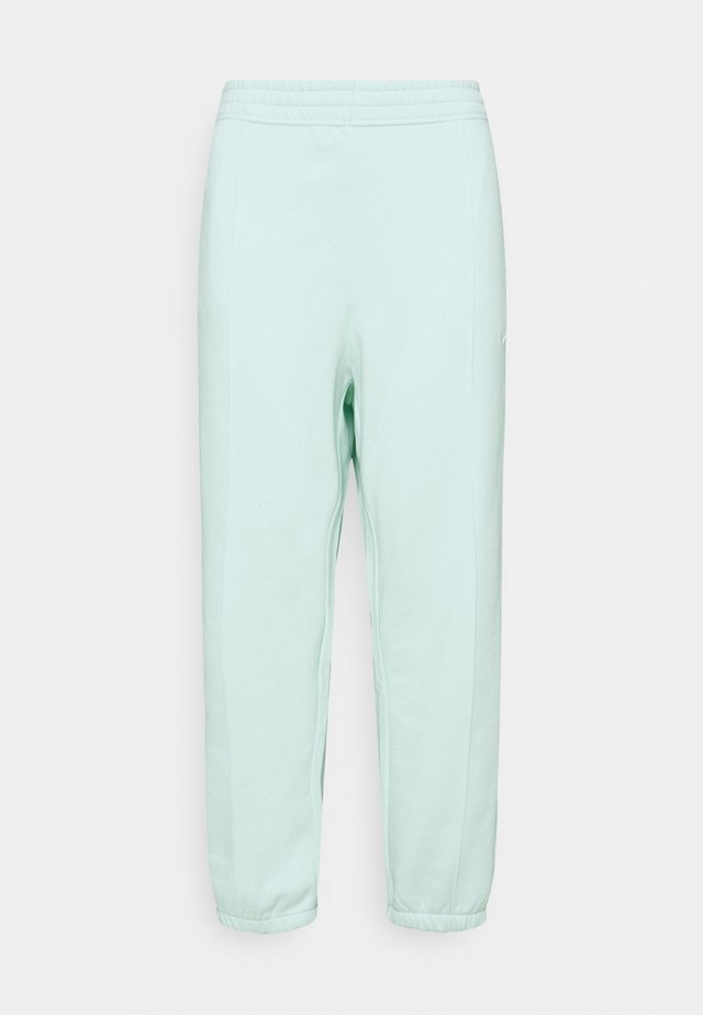 PANT TREND PLUS - Trainingsbroek - barely green/white