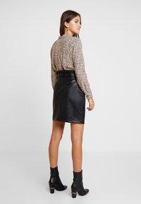 Vero Moda - VMEVA PAPERBAG SHORT SKIRT - Mini skirt - black - 2