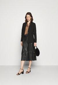Marks & Spencer London - CIRCLE SKIRT - A-line skirt - black - 1