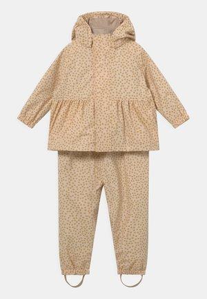 PALME RAINWEAR GIRL SET - Pantalones impermeables - buttercup yellow