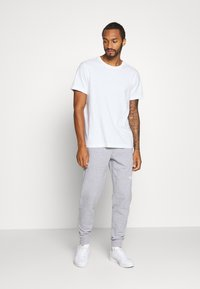 The North Face - STANDARD PANT - Spodnie treningowe - light grey heather - 1