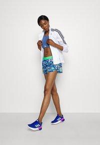 adidas Performance - ADIZERO SPLIT - Pantalón corto de deporte - bold blue/semi screaming green - 1