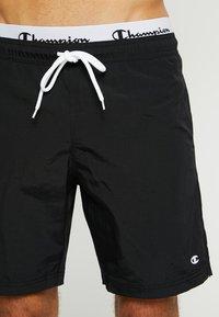 Champion - BEACH - Swimming shorts - black - 3