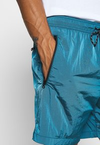 American Eagle - IRIDESCENT ALL DAY  - Tracksuit bottoms - bright blue - 4
