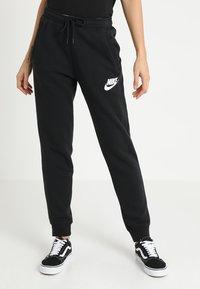 Nike Sportswear - RALLY  - Træningsbukser - black/white - 0
