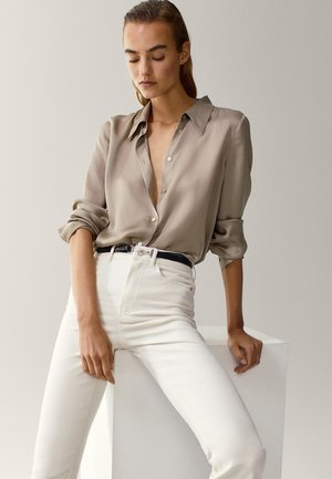 SCHLAG AUS HOHEM  - Flared Jeans - beige