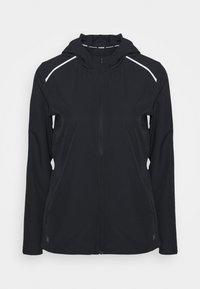 Under Armour - OUTRUN THE RAIN JACKET - Sports jacket - black/white - 3