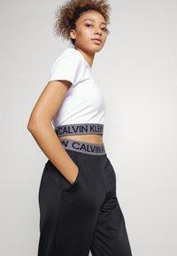 Calvin Klein Performance - PANT - Pantalon de survêtement - black - 3