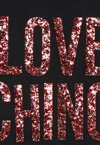 Love Moschino - Print T-shirt - black - 6