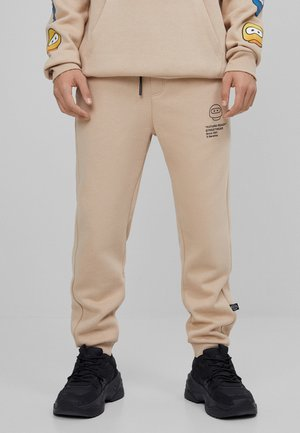 FUTURE-READY  - Tracksuit bottoms - beige