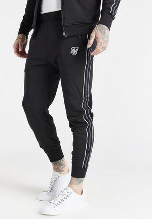 STATUS TAPE CUFFED PANTS - Tracksuit bottoms - black