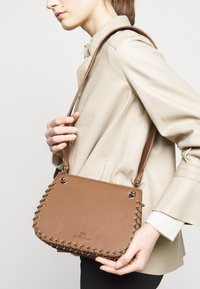 Elisabetta Franchi - PIERCING SADDLE SHOULDER BAG - Across body bag - mou - 1