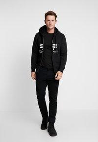 Alpha Industries - Zip-up hoodie - black - 1
