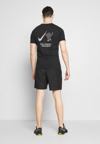 Nike Performance - RUN SHORT - Pantalón corto de deporte - black - 2
