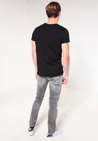 Replay - HYPERFLEX ANBASS - Slim fit jeans - grey denim - 2