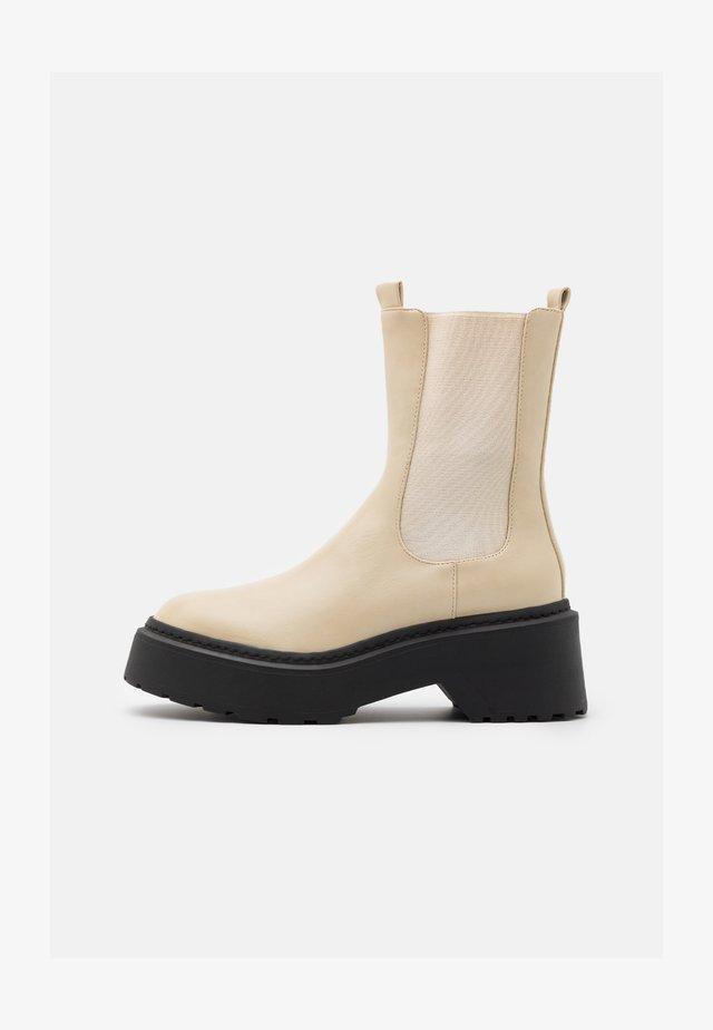 EDIE - Platform ankle boots - cream
