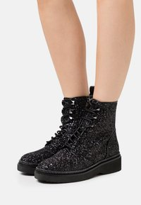 MICHAEL Michael Kors - HASKELL BOOTIE - Lace-up ankle boots - black - 0