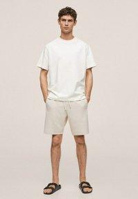 Mango - FUNCHAL - Shorts - open beige - 1