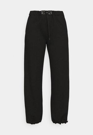 TRACK PANTS - Verryttelyhousut - joris/black