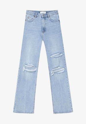 VINTAGE - Široké džíny - light blue