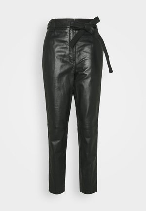 INDIE TROUSERS - Leather trousers - caviar
