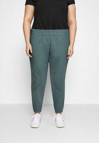 Nike Sportswear - PANT TREND PLUS - Tracksuit bottoms - hasta/white - 0