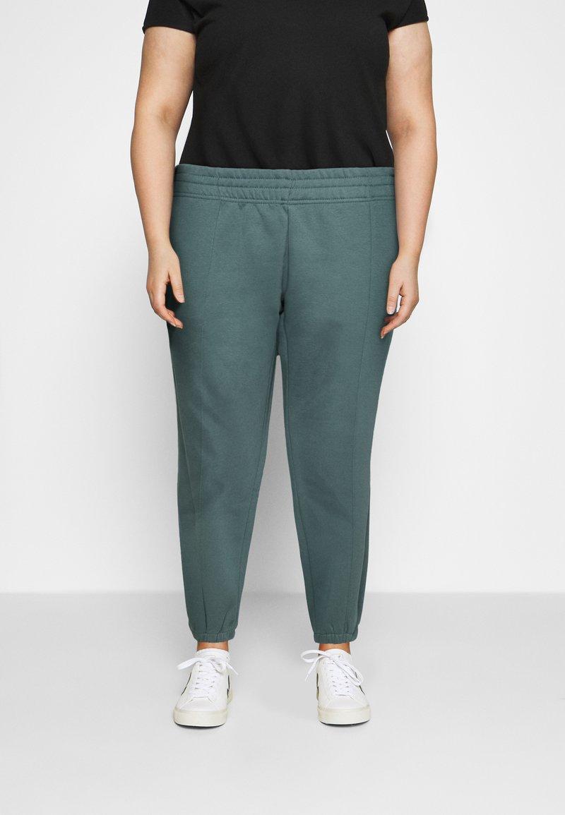 Nike Sportswear - PANT TREND PLUS - Tracksuit bottoms - hasta/white