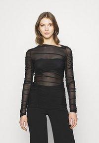 Weekday - MARGERIE LONG SLEEVE - Long sleeved top - solid black - 0