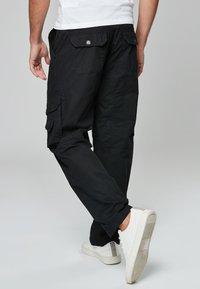 Next - TECH - Cargo trousers - black - 1