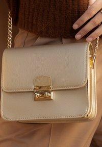 Violet Hamden - Across body bag - gold - 1