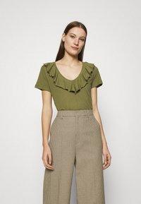 Mos Mosh - FLOUNCE TEE - Basic T-shirt - capulet olive - 0