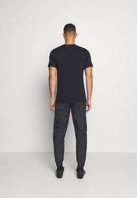 Nike Performance - PARIS ST GERMAIN PANT - Club wear - black/truly gold - 2