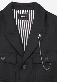 The Kooples - EN LAINE BOUTONNÉ À COL CRANTÉ - Light jacket - black - 7