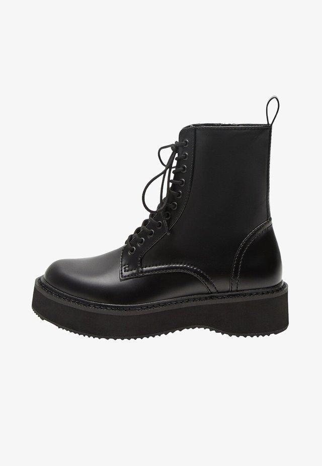 NICOLA - Platform ankle boots - schwarz