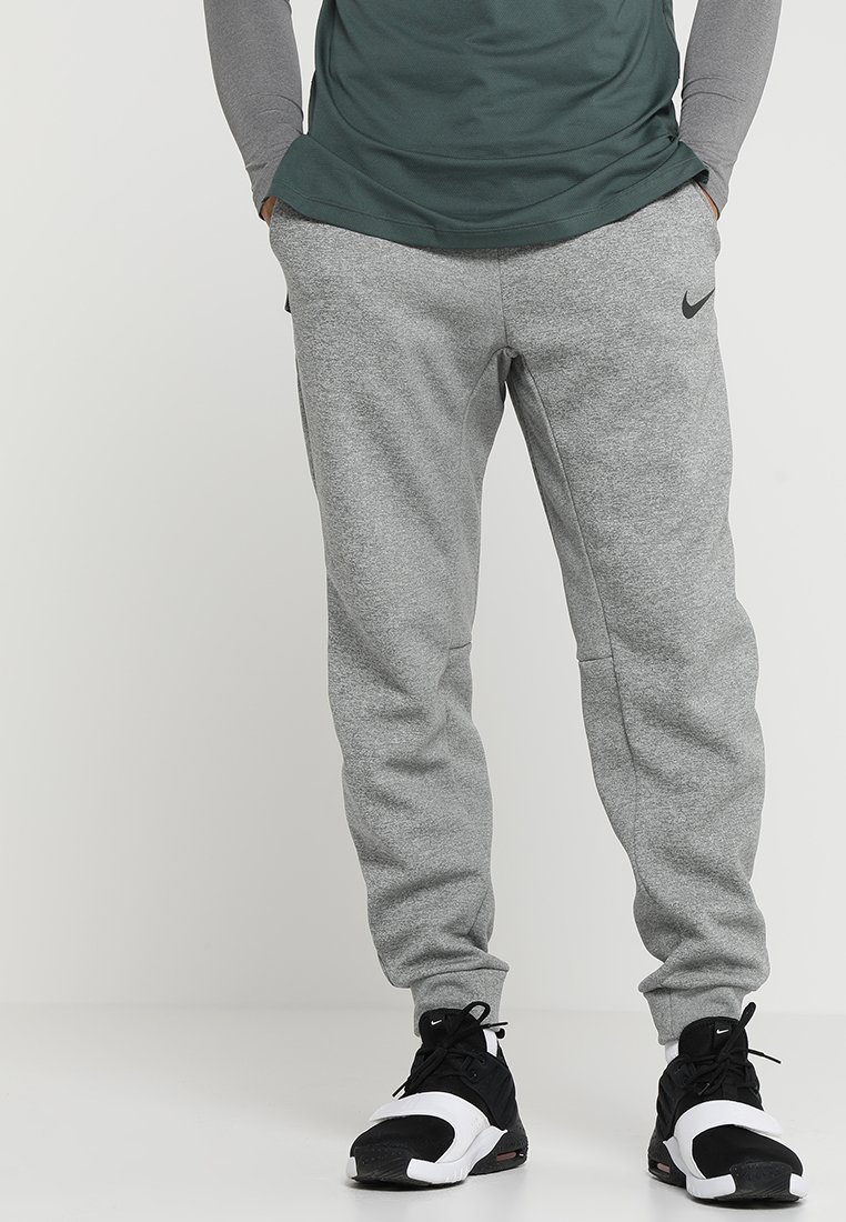 Nike Performance - THRMA TAPER - Pantalon de survêtement - dark grey heather/black